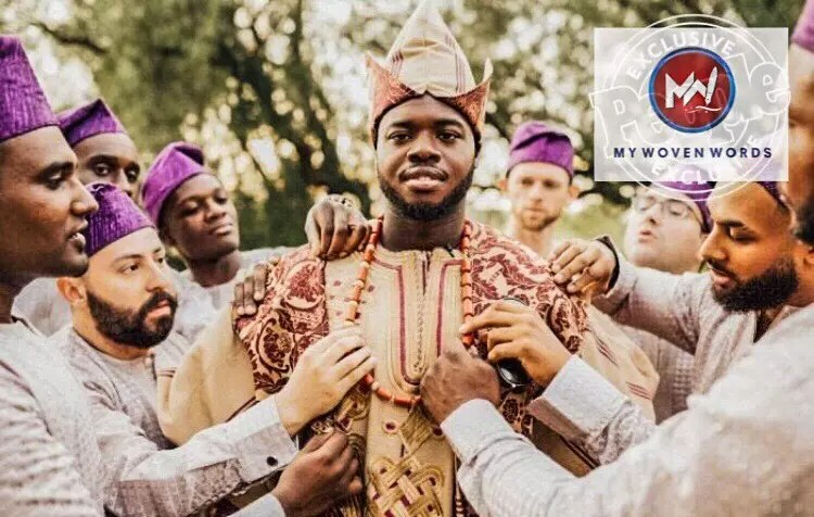 Kevin Olusola dressed up for Nigerian wedding, with his friends all wearing the Yoruba cap and he putting on the 'dog-eared cap' (Abetíajá)