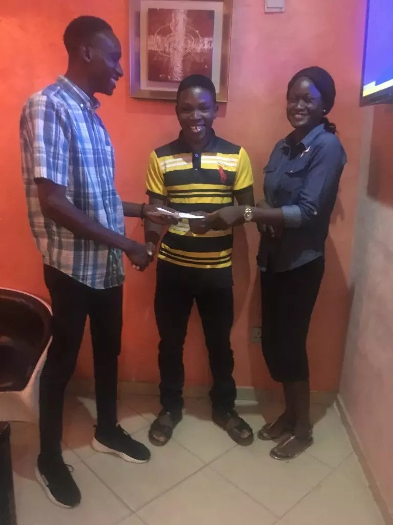 The First Runner of OSCA Woven Words Competition; Temitope Alo receiving her cash prize of N30,000 from Hannah Akanbi and Johnson Okunade