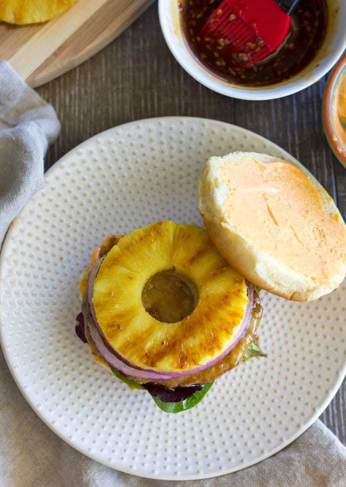 Grilled Teriyaki Turkey Burgers with grilled pineapple, red onion, mixed greens and a spicy Sriracha mayo. So easy and so yummy!