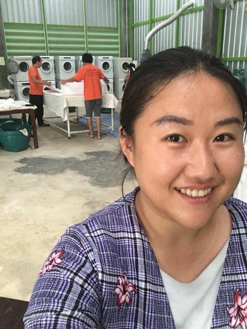 She is the owner of the washing store,doing free-washing the rescue team's clothes.