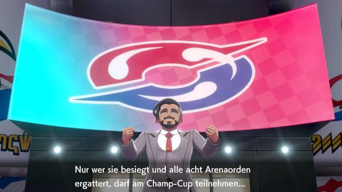 Das Foto zeigt den Pokémon Präsidenten Galars, welcher eine Rede im Stadion bzw. einer Arena hält.