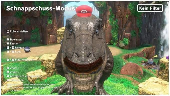 Das Foto zeigt einen Dinosaurier mit Mario-Kappe und Bart in Super Mario Odyssey für die Nintendo Switch.