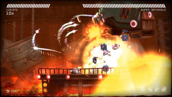 Das Foto zeigt eine Action-Sequenz aus Rive: Ultimate Edition. Zu sehen sind Explosionen und feindliche Flugobjekte inmitten von Flammen.