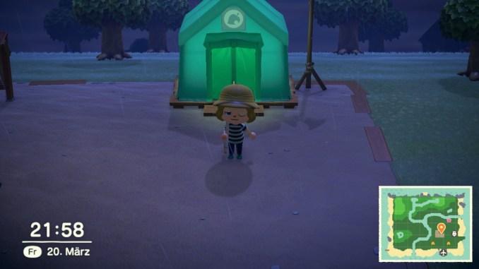 Das Bild zeigt einen wichtigen Teil von Animal Crossing: New Horizons. Der Avatar steht vor dem Servicezelt. Das Zelt ist in grün und über dem Eingang hängt das klassische Tanuki-Symbol.