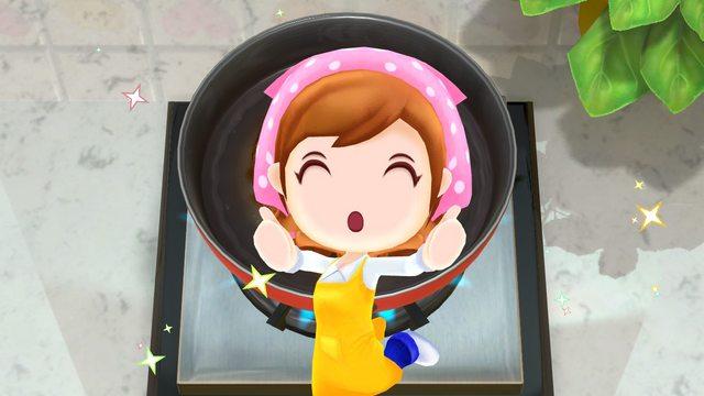 Das Bild zeigt die Mama in Cooking Mama: Cookstar. Sie zeigt uns beide Daumen hoch und freut sich sehr.