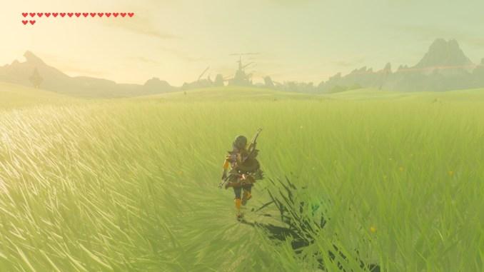Breath of the WIld – Dieses Bild zeigt Link auf freier Fläche mit dem Schloss Hyrule im Hintergrund.