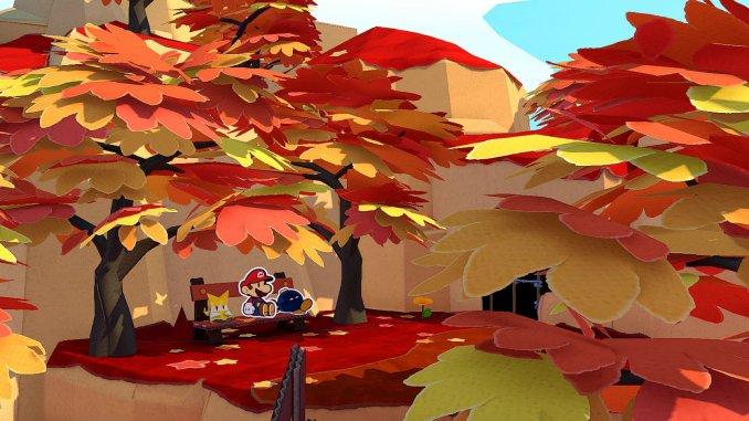 """Das Bild zeigt eine sehr friedliche Szene """"Paper Mario: The Origami King"""". Man erkennt einen Wald in Herbstfarben. Mario und ein Oh-Bomb sitzen auf einer Bank."""