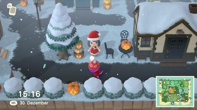 """Das Bild zeigt gruselige Kürbisse im Schnee in """"Animal Crossing: New Horizons""""."""