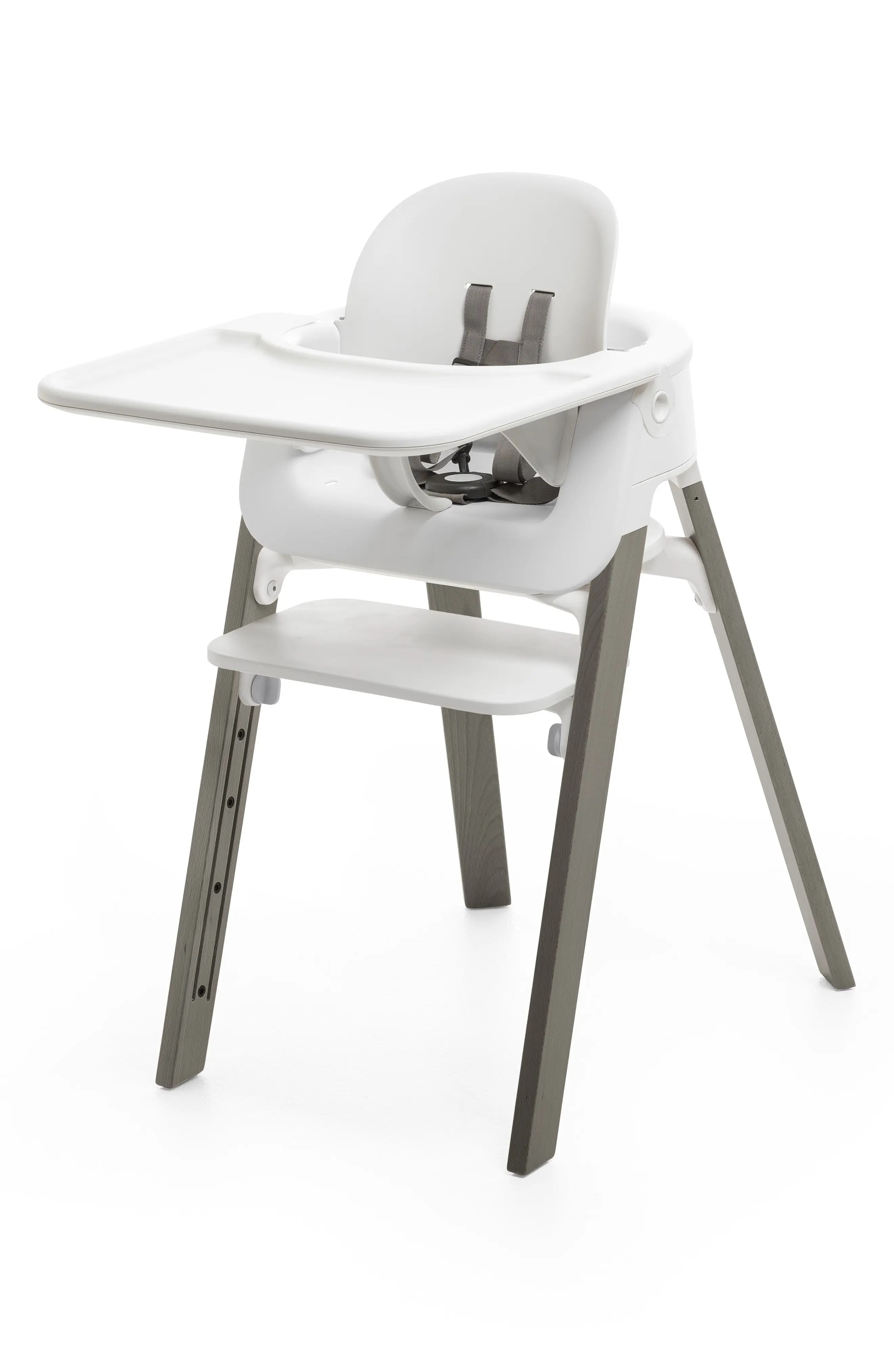stokke high chair purple dining chairs and table covers booster seats for tables nordstrom steps tray