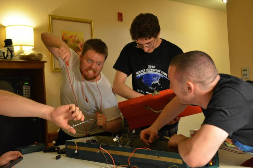 Mars Rover electrical team and I making aggressive electrical modifications and repairs to Phoenix
