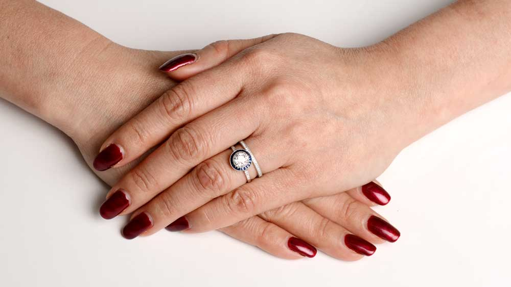 Engagement Ring and Wedding Band on ladies Finger