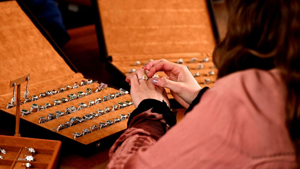 Customer looking at Estate Diamond Jewelry diamond engagement ring