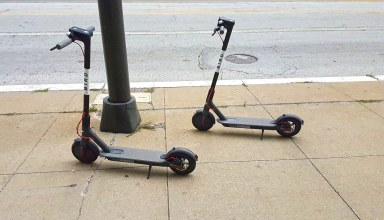 Scooters parked on the pavement