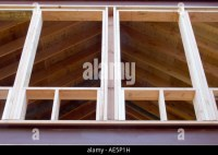 Metal and wood framing of room with cathedral ceilings and ...