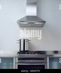 Extractor fan above hob in black granite island unit in ...