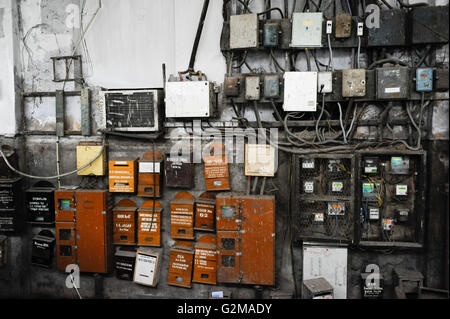 Electricity meter in box with old style fuses circa 1962 in New Stock Photo Royalty Free