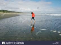 Woman Walking Beach Wearing Stock &