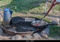 Person Cooking Over Campfire Stock Photos & Person Cooking ...