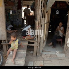 Plastic Toddler Chair Kid Chairs Cambodia Poverty Slum Stock Photos & Images - Alamy