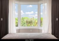 Bay Window Curtains Stock Photos & Bay Window Curtains ...
