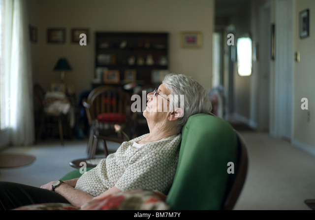 pier 1 chair swing frame sleeping pensioner stock photos & images - alamy