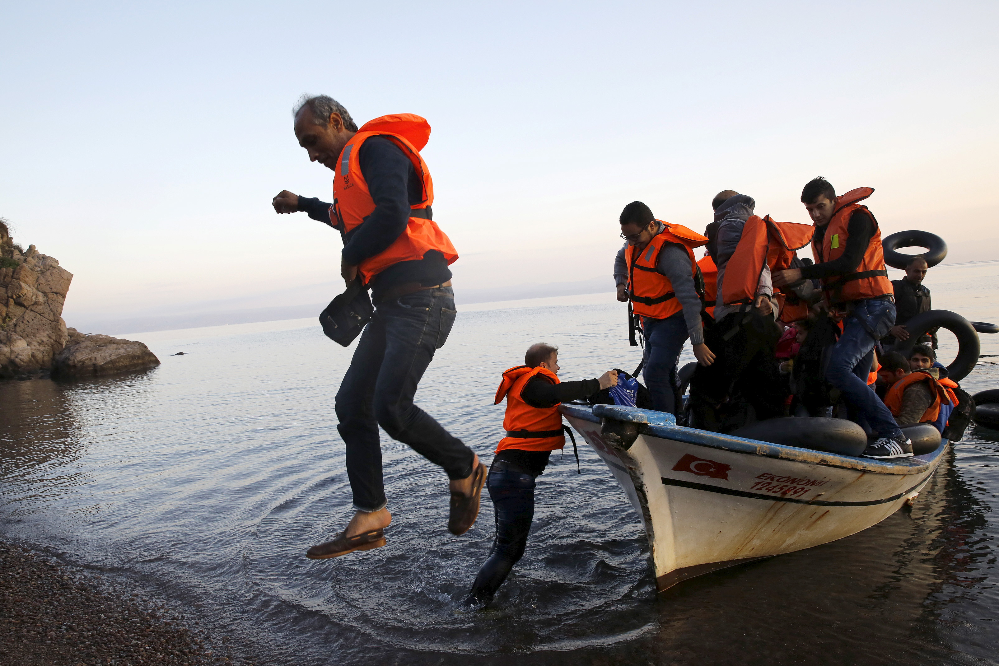 "In a six-part series of 10-minute videos, ""The Journey from Syria,"" The New Yorker records the harrowing trip of a refugee—not unlike those shown here, disembarking from a fishing boat on a beach on the Greek island of Lesbos—as he escapes Damascus for Europe"