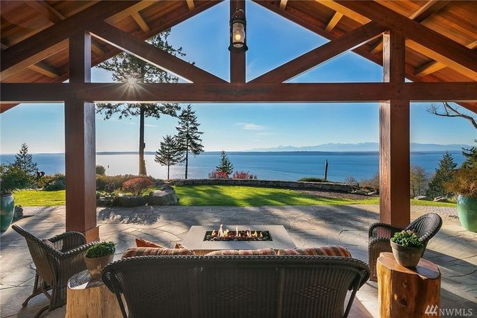 Patio with fire pit and water views