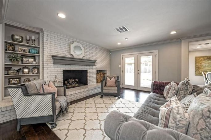 Red-brick fireplace was painted white.