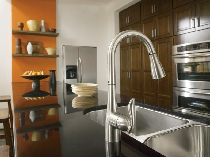 A low-flow kitchen faucet limits the flow of water to 2.2 gallons per minute, or less.