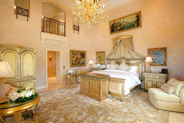 The POTUS could catch some serious ZZZs in this gilded master bedroom complete with a canopy and gold chandelier.