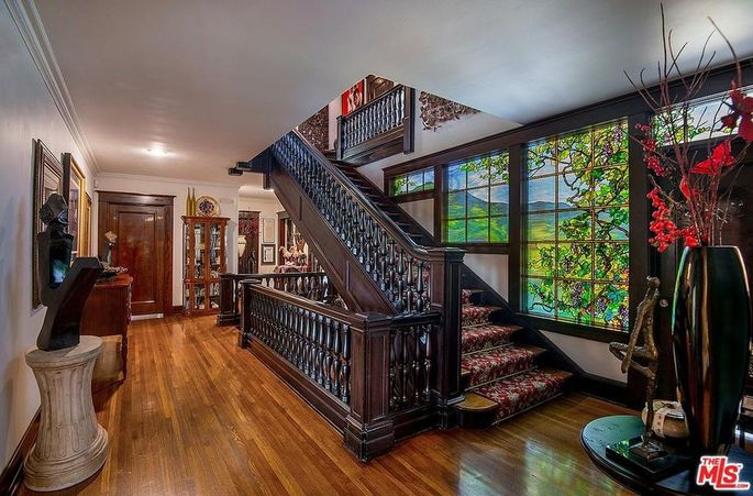 Staircase and stained-glass window
