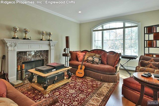"""Family room with """"DWTS"""" trophy display"""