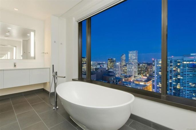 Luxe bath with city views