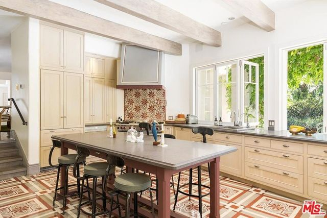Kitchen with exposed beam and colorful tile