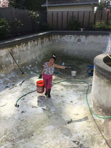 Removing old plaster from concrete pool
