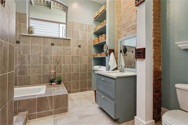 Spa like bathroom with original brick wall
