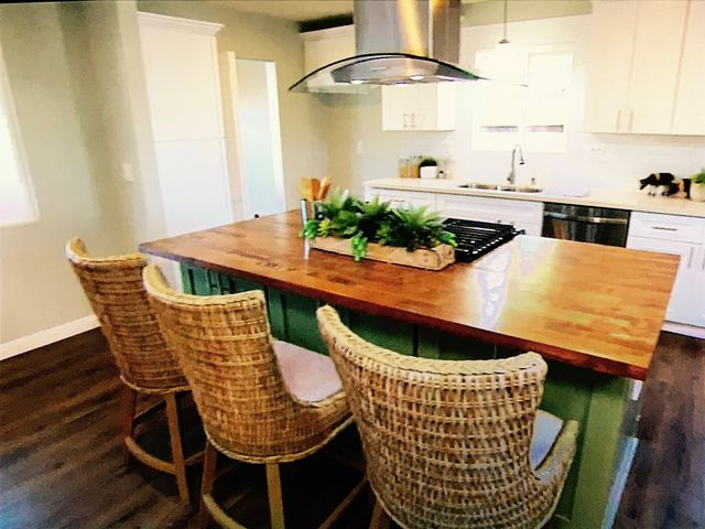 Tarek's olive green island with the butcher block top doesn't exactly mesh with the home's super modern vibe.