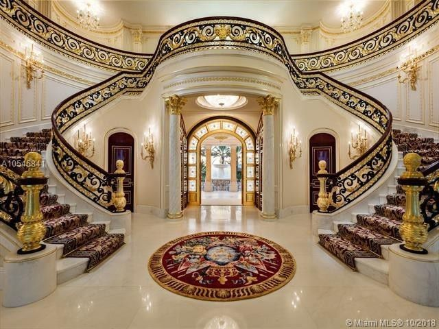 The dramatic grand foyer with a double staircase