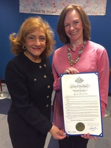 """Commissioner of the New York State Office of Alcoholism and Substance Abuse Services Arlene González-Sánchez presenting Kirsty Cardinale, Director of Marketing & Communications at NAAP, with the Proclamation establishing Problem Gambling Awareness Day on March 30, 2016, in Albany, NY."""""""