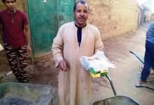 Photo of مسيحيين يقدمون الطعام للعاملين فى بناء مدرسة للقرآن الكريم بجنوب قنا