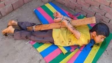 Photo of أب يقوم بتعذيب نجله وربطه بحبل وخشب أعلى سطح المنزل بالقليوبية