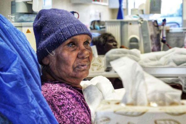 Elderly Aboriginal woman in hospital bed