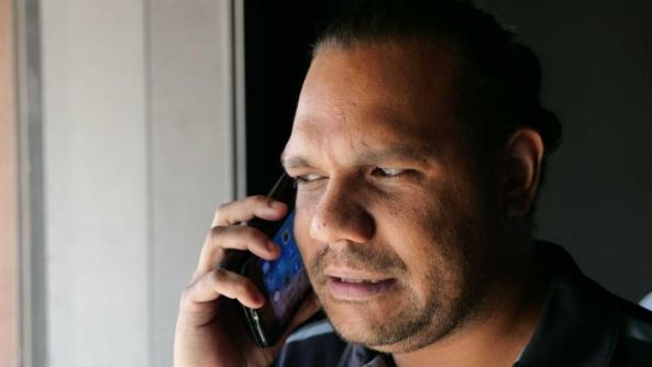 Aboriginal man talking on his mobile phone