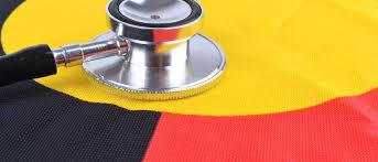 stethoscope on centre of Aboriginal flag