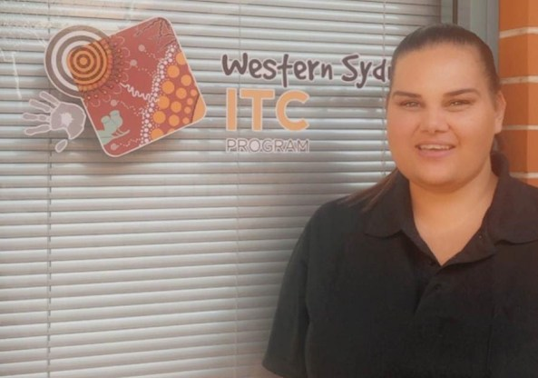 Aboriginal health worker standing in front of window with words Western Sydney ITC Program