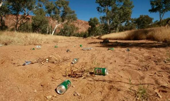 empty VB cans dry sandy riverbed