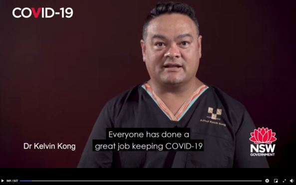 image from COVID-19 DoH video featuring Associate Professor Kelvin Kong in scrubs talking about getting tested if you have COVID-19 system, even if you have previously been tested
