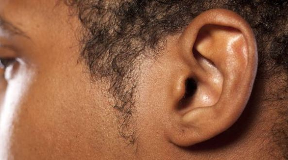 close up photo of an Aboriginal man's ear