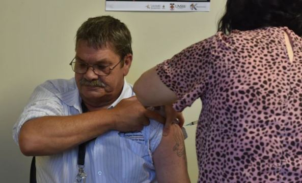 Indigenous transport worker Peter Brennan receiving COVID-19 vaccine