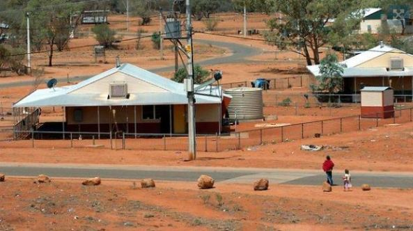two houses in community of Mimili APY Lands, red dust, no grass, few trees